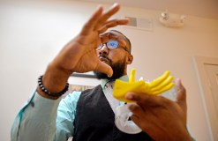 Three-Handed: Rashad Glover, founder of Global Glover Technologies, with his 3-D printed prosthetic arm prototype. | ALEXA ROGALS/Staff Photographer