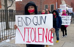NEVER AGAIN: Students walk along the side walk and silently protest last Wednesday, during a walkout for students who have lost loved ones to gun violence outside of North Lawndale College Prep in Chicago. | ALEXA ROGALS/Staff Photographer