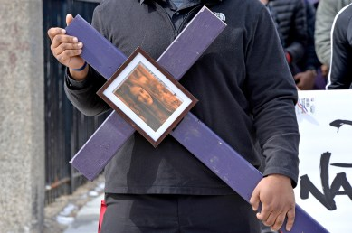 SPEAKING OUT: A student holds up a sign and wears duct tape with the names of people killed last Wednesday, during a walkout for students who have lost loved ones to gun violence outside of North Lawndale College Prep in Chicago. | ALEXA ROGALS/Staff Photographer