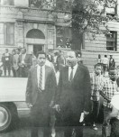 HIDDEN HISTORY: Left, Martin Luther King Jr. walks out of his North Lawndale apartment building in 1966. The apartment was a block away from Del-Kar Pharmacy. | Submitted photo