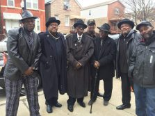 """West Side bluesmen outside New Landmark MBE Church before the funeral of Michael """"Sleepy"""" Riley. From left: James Carter, drums; Tony Owens guitar; Larry Taylor, vocal and drums; Jimmy, guitar; Carl Norrington bass; Joe B guitar; Lawrence J, guitar."""