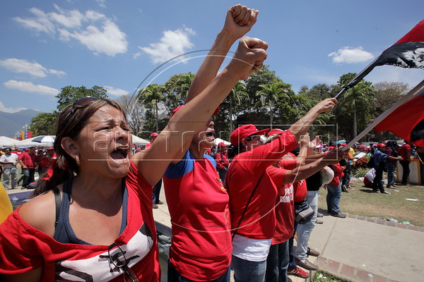 Crowds gathered early for the funeral of Hugo Chavez in Caracas, Venezuela. Some people passed out and others broke through a police line. (Australfoto/Douglas Engle)