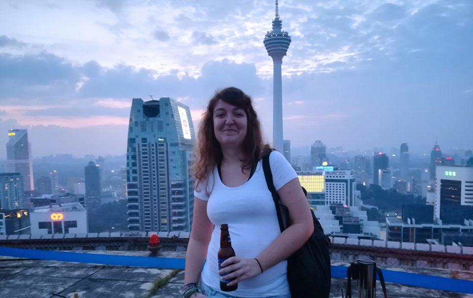 Photo of me on the helipad skybar in Kuala Lumpur, Malaysia - Hannah Cackett owner, Authentic gems travel blog