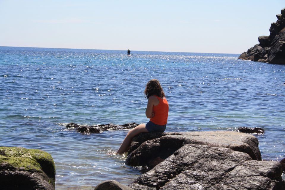Photo of me sat alone on a rock in the sea taken in cornwall, England