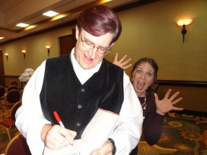 James Owen is too busy drawing dragons in book inscriptions to notice I'm sneaking up behind him. (At the ANWA Conference, Arizona, 2013)