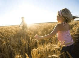 girl-running-through-wheat