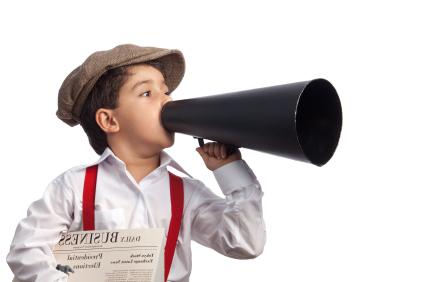 little boy holding newspaper and megaphone