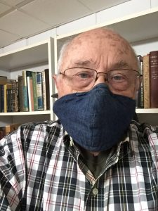 advises reader to wear a mask