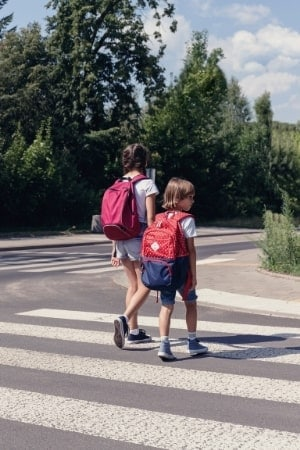 children crossing a road