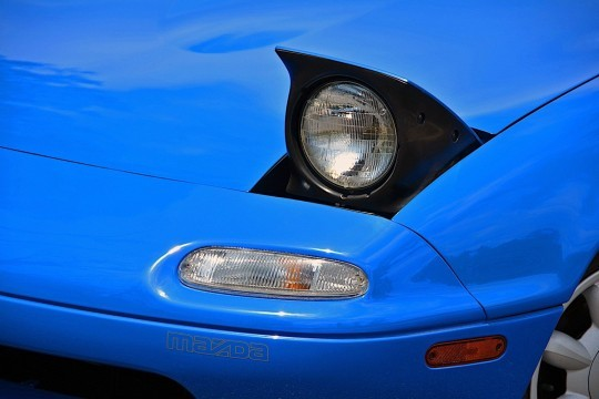 Ten Iconic Cars with Concealed Headlights