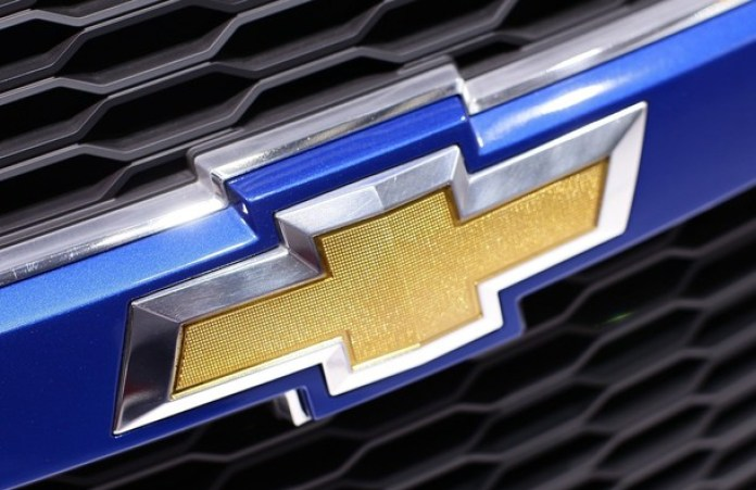 A Chevrolet logo is seen on a car displayed on the exhibition stand of Chevrolet during the 80th Geneva Car Show