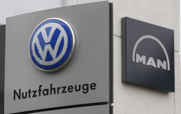 Signs of VW and MAN are pictured at a truck service centre in Dortmund