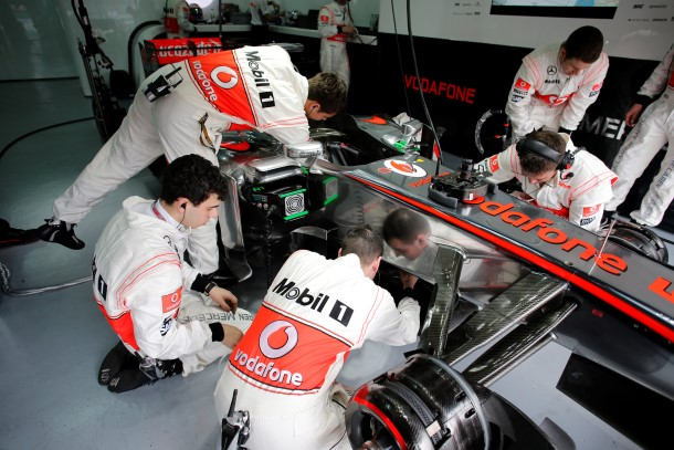 Mechanics at work on the car in the garage
