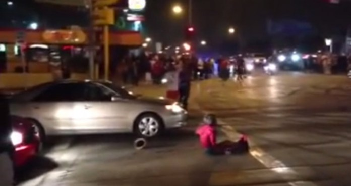 Lady gets struck by a car , resulting in chaos... Crenshaw Takeover 2013
