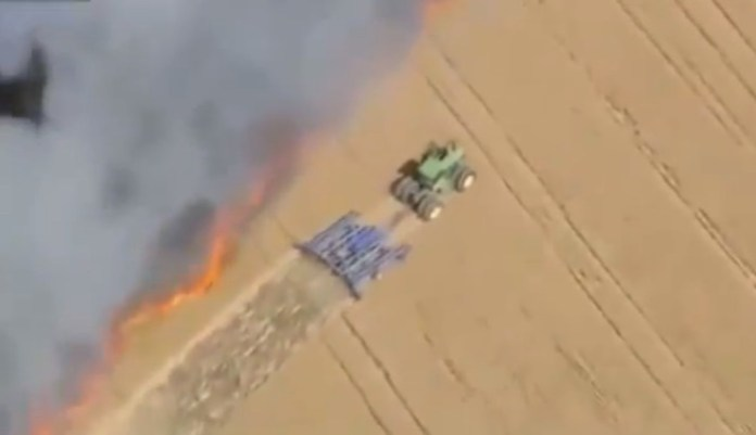 Farmer Digs Fire Line With Tractor
