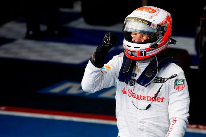 Kevin Magnussen celebrates his podium finish.