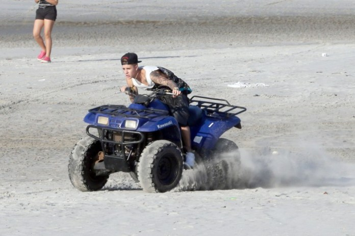 Justin Bieber looks incredibly emotional as he films an impromptu video on a quad bike on the beach in Panama