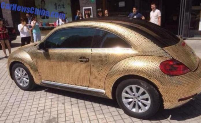 Volkswagen Beetle covered with coins (2)