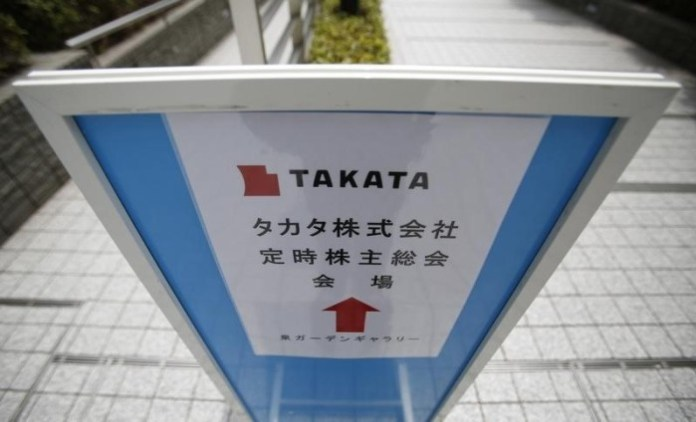 A sign board of Japanese auto parts maker Takata Corp's Annual General Meeting is seen on a street near the venue in Tokyo