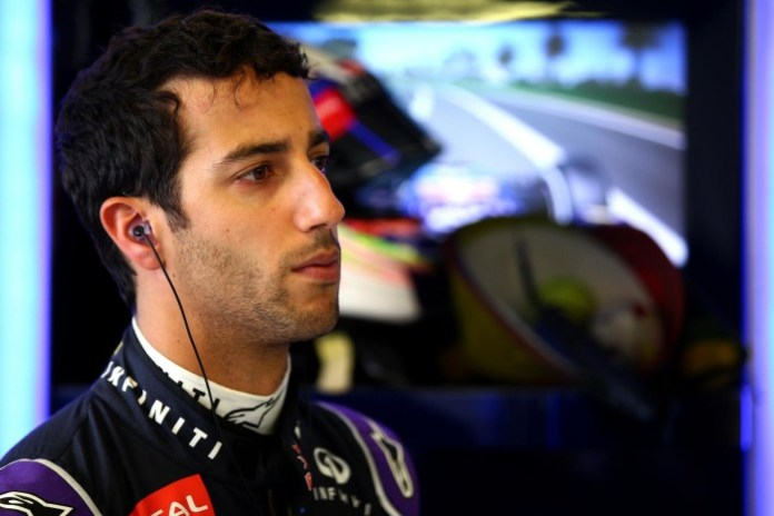 MELBOURNE, AUSTRALIA - MARCH 13: Daniel Ricciardo of Australia and Infiniti Red Bull Racing looks on in the garage during practice for the Australian Formula One Grand Prix at Albert Park on March 13, 2015 in Melbourne, Australia. (Photo by Mark Thompson/Getty Images)