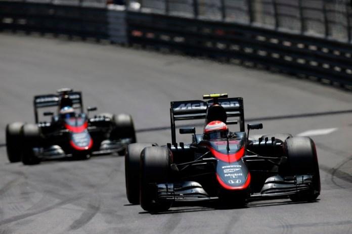 Jenson Button leads Fernando Alonso.