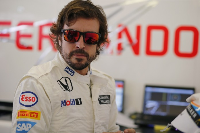 Fernando Alonso in the garage.