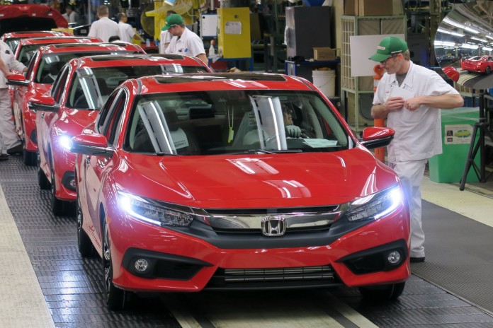 Honda of Canada Mfg. associates perform final inspections on an