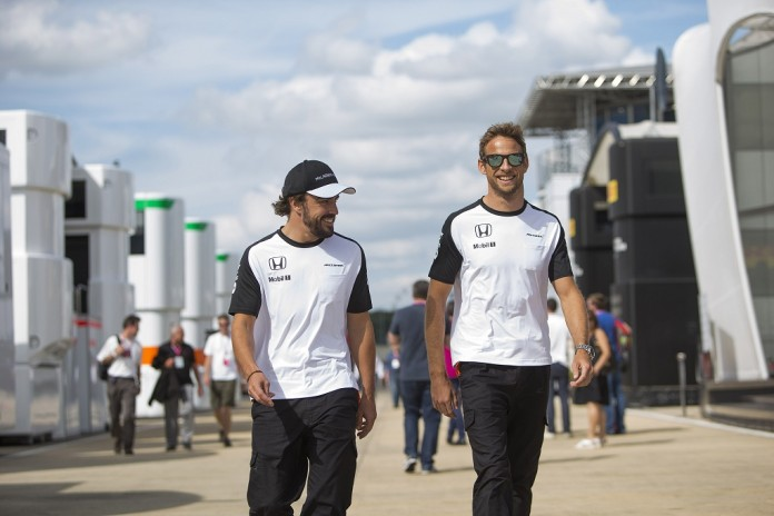 Fernando Alonso and Jenson Button in the paddock.