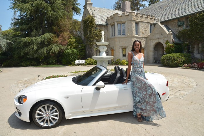 """""""LOS ANGELES, CA - MAY 11: 2016 Playmate of the Year Eugena Washington poses with her new All-New 2017 Fiat 124 Spider at Playboy's 2016 Playmate of the Year Announcement at the Playboy Mansion on May 11, 2016 in Los Angeles, California. (Photo by Charley Gallay/Getty Images for Playboy)"""""""