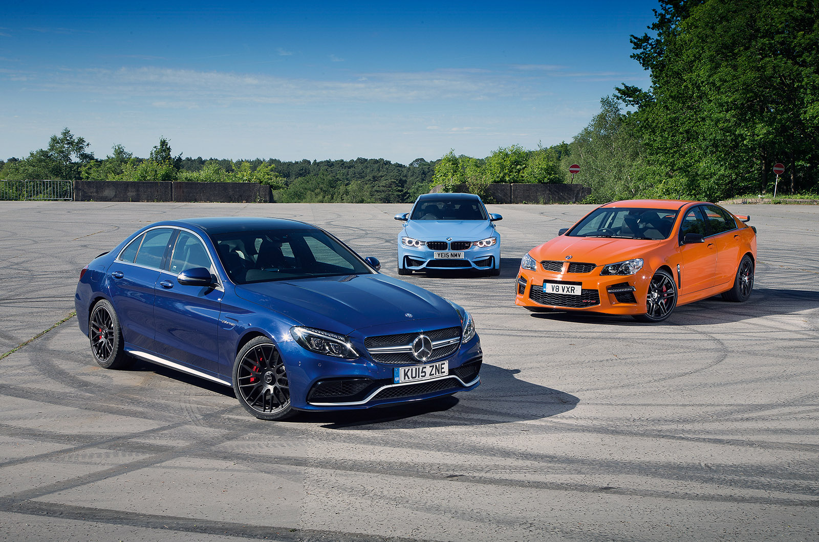 hight resolution of mercedes amg c63 versus bmw m3 and vauxhall vxr8 gts