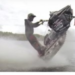 This guy is wheeling on water with a SNOWMOBILE ! How's that for craziness?