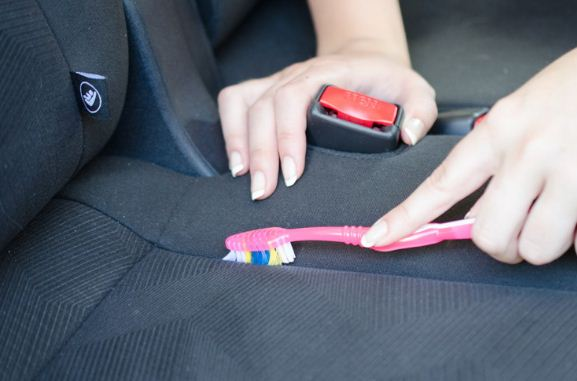 Toothbrush to clean car seats