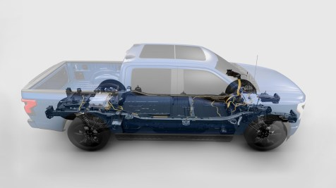 2022 Ford F-150 Lightning. Pre-production model with available features shown. Available starting spring 2022. FordPass App, compatible with select smartphone platforms, is available via a download. Message and data rates may apply.