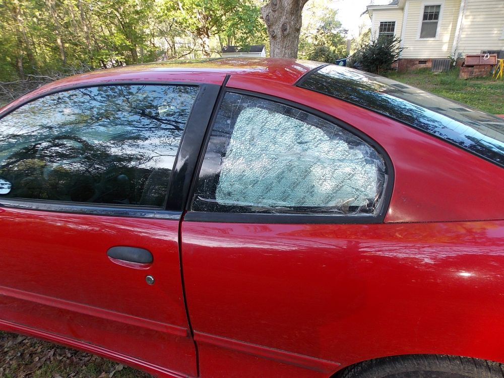 medium resolution of  2002 pontiac sunfire 2 door coupe driver s side quarter glass