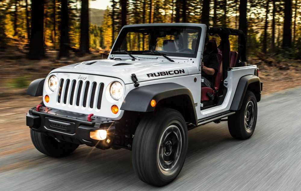 medium resolution of a white 2013 jeep wrangler rubicon is driving