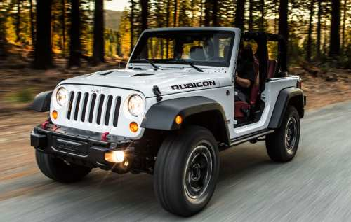 small resolution of a white 2013 jeep wrangler rubicon is driving
