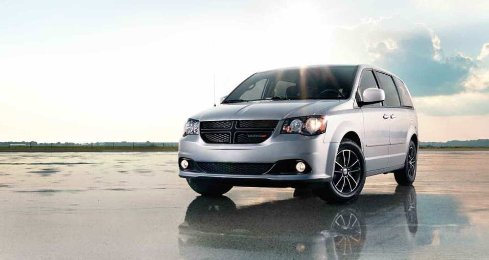 medium resolution of a silver 2015 dodge grand caravan is parked in an open area