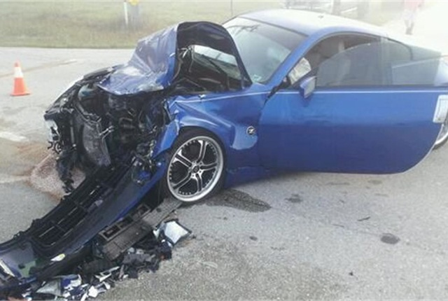 Last week this sports car collided with a school bus during thick morning fog in Cape Coral, Fla. Photo courtesy of Cape Coral Fire Department Twitter page.