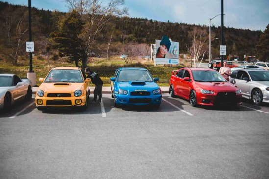 photo of cars parked on parking space