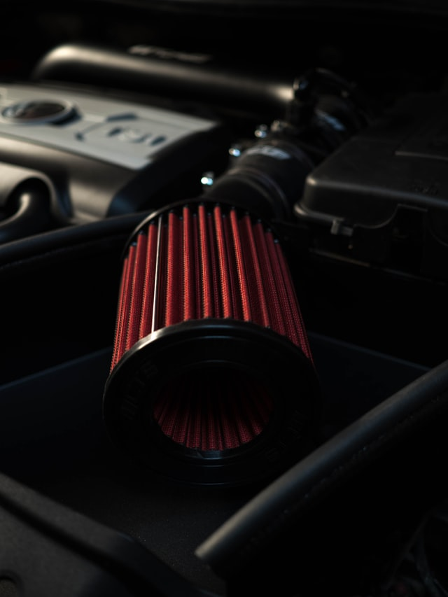 Red internal air filter for a car.