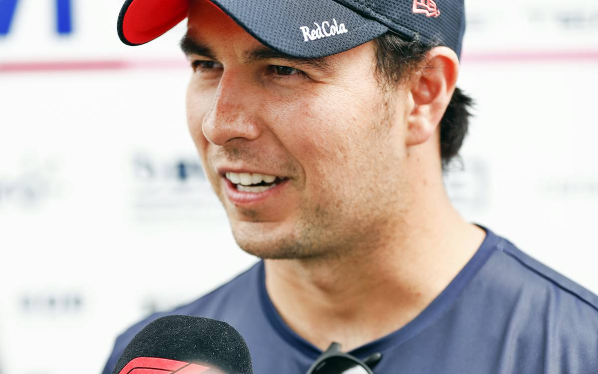 Sergio Perez, Racing Point, talks to the press