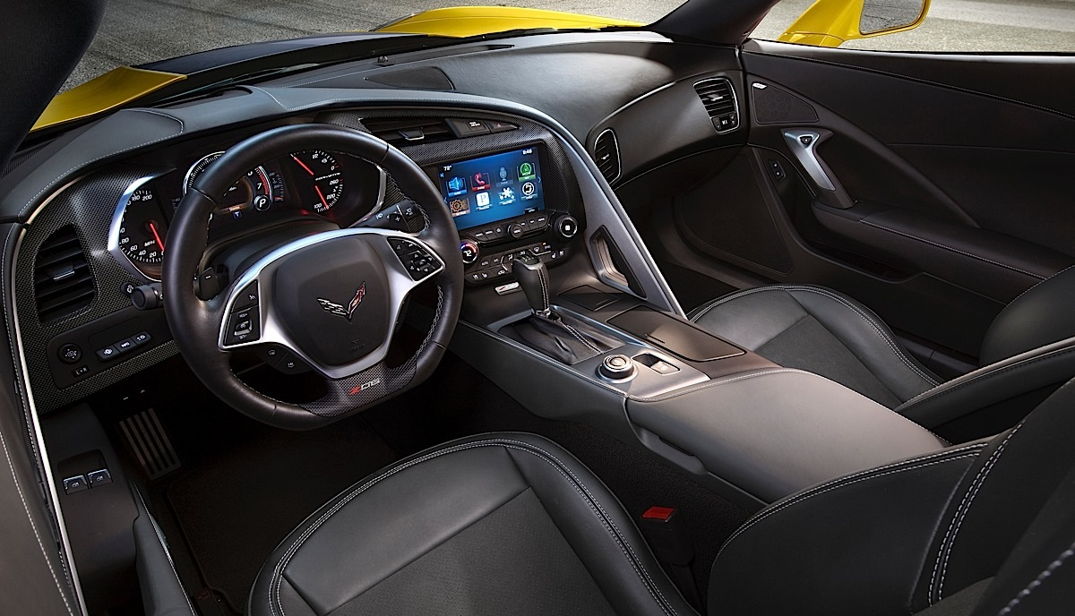 The 2015 Corvette Z06 is distinguished from the Corvette Stingray by unique color schemes that emphasize the driver-focused cockpit, and a unique, flat-bottomed steering wheel.