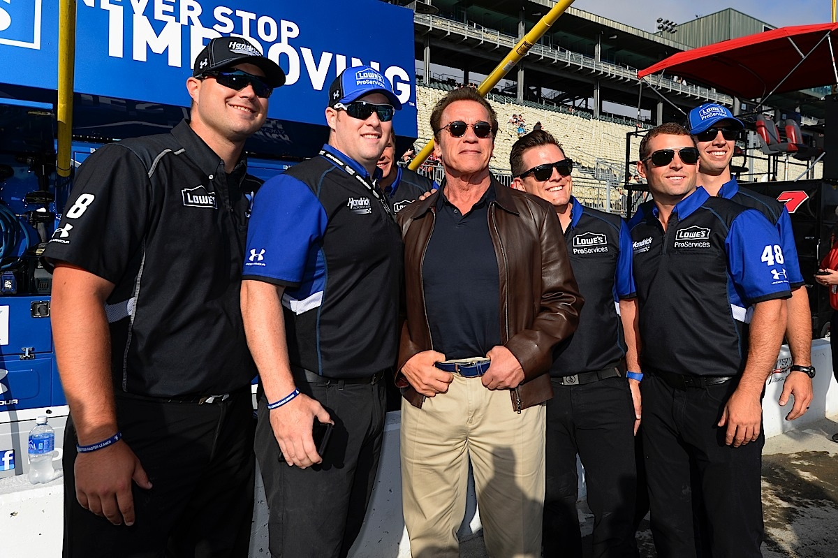 SONOMA, CA - JUNE 28:  Actor and former governor of California Arnold Schwarzenegger poses for a picture with crew members for the #48 Lowe's Pro Services Chevrolet prior to the NASCAR Sprint Cup Series Toyota/Save Mart 350 at Sonoma Raceway on June 28, 2015 in Sonoma, California.  (Photo by Robert Laberge/Getty Images) *** Local Caption *** Arnold Schwarzenegger