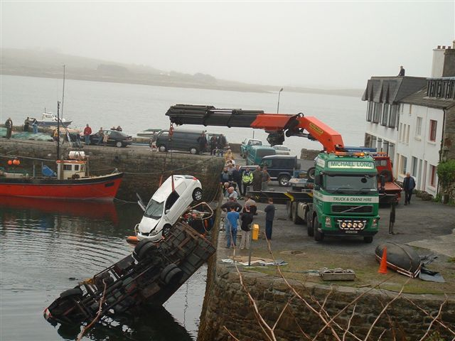 Scene 5 -- Second crane  retrieving white automobile.