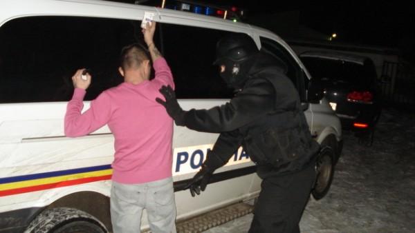 Prins în urma unei razii a polițiștilor