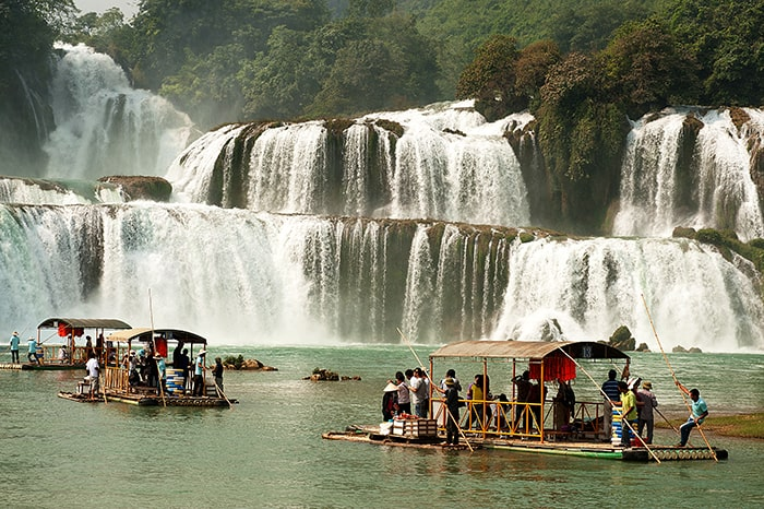 NANNING,CHINA - OCT 11 : Traveler enjoy the beauty of nature by rafting at Datian waterfall,it is currently the 4th largest waterfall along a National border on October 11,2014 in Daxin ,Nanning,China.
