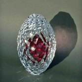 """Embryo 2015"", Cased Glass, solid inner, transparent ruby. 125 Ø x 210. Deep carved lenses."