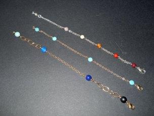 "Sheail Westera, ""Armbandjes"" klein model met diverse edelsteentjes, in gewalst goud en zilver."