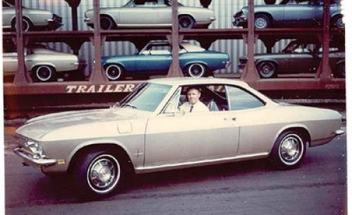 I'm seeing the Corvair but can't help notice the Nova's on the rail car.