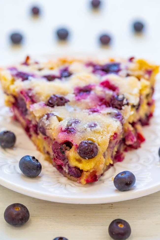 Crustless Blueberry Pie – a FAST, crustless, no-mixer dessert that's perfect for summer entertaining, picnics, or potlucks!! Somewhere in between pie, cake, and blondies is what you get with this FABULOUS blueberry dessert recipe! Take advantage of those FRESH blueberries!!